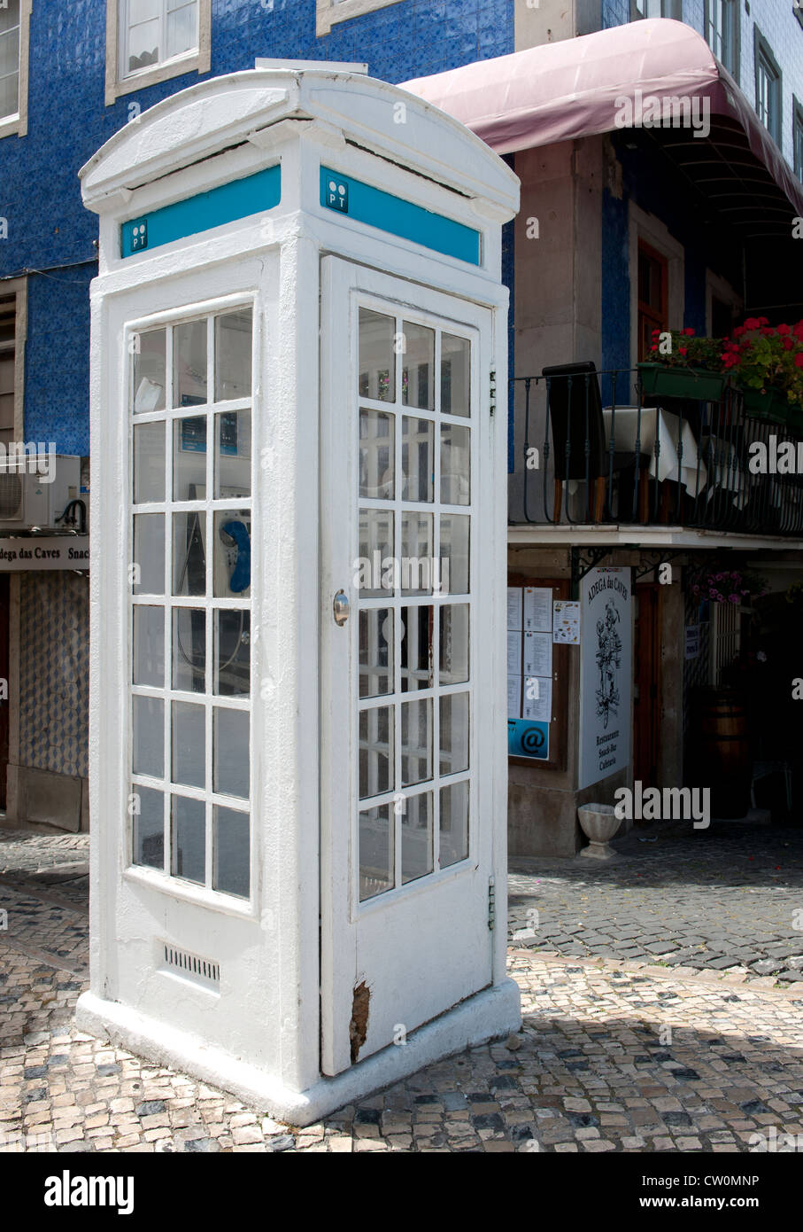 Public telephone kiosk (box) in town centre at Sintra, Portugal. - Stock Image