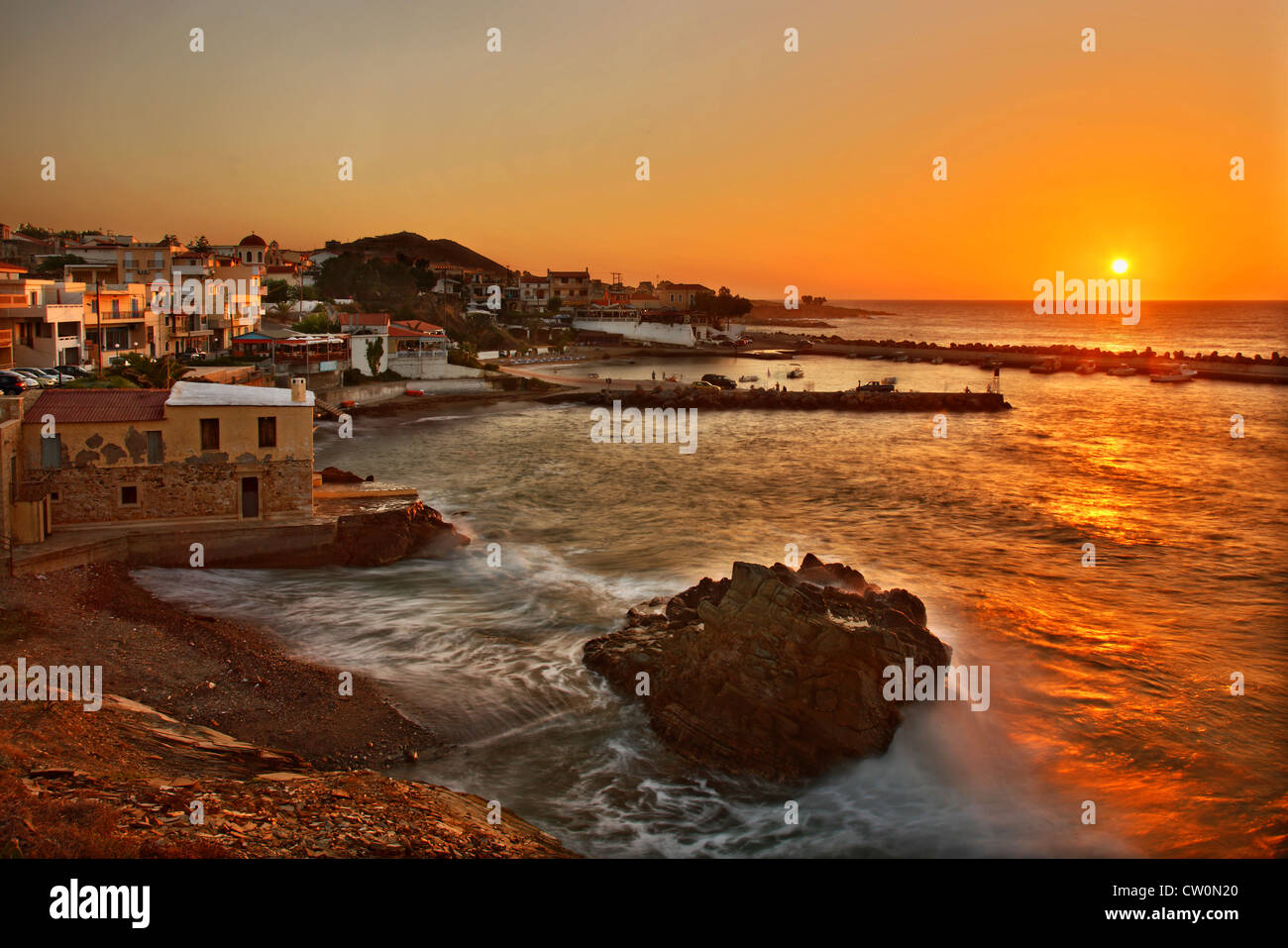 Sunset at Pamormos village, popular touristic resort, at Rethymnon prefecture, Crete, Greece - Stock Image