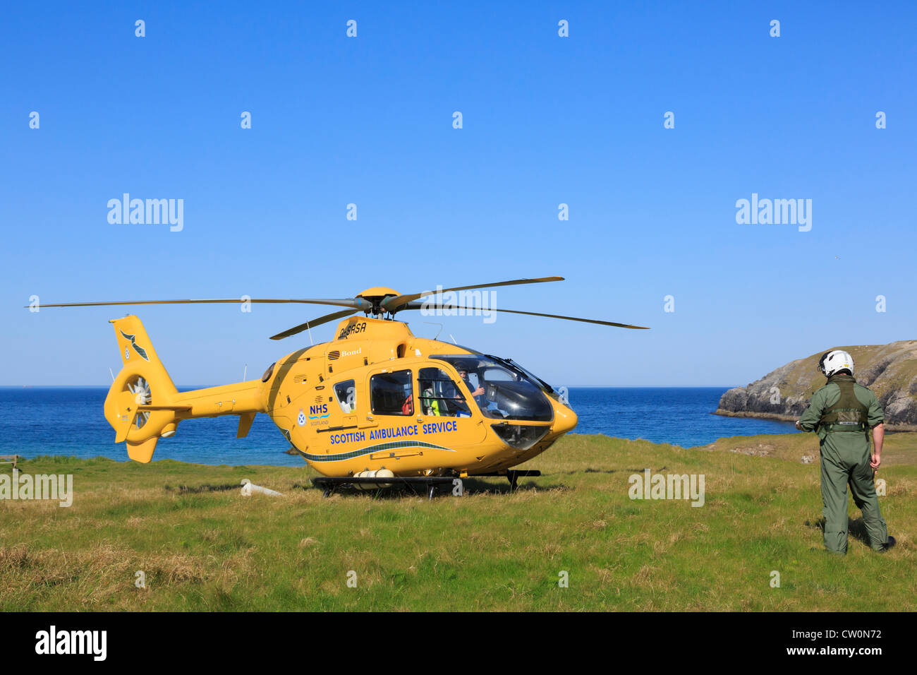 Scottish Air Ambulance Service Helicopter preparing to take off after a rescue mission on remote North West Highlands - Stock Image