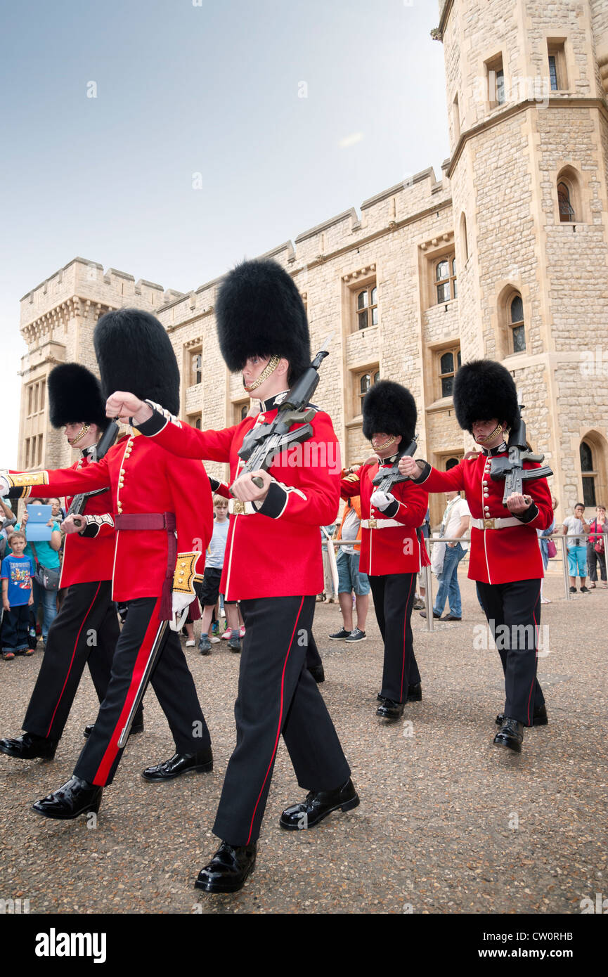 Royal Scots guards marching in front of the Jewel House at the changing of the guard. Tower of London UK - Stock Image