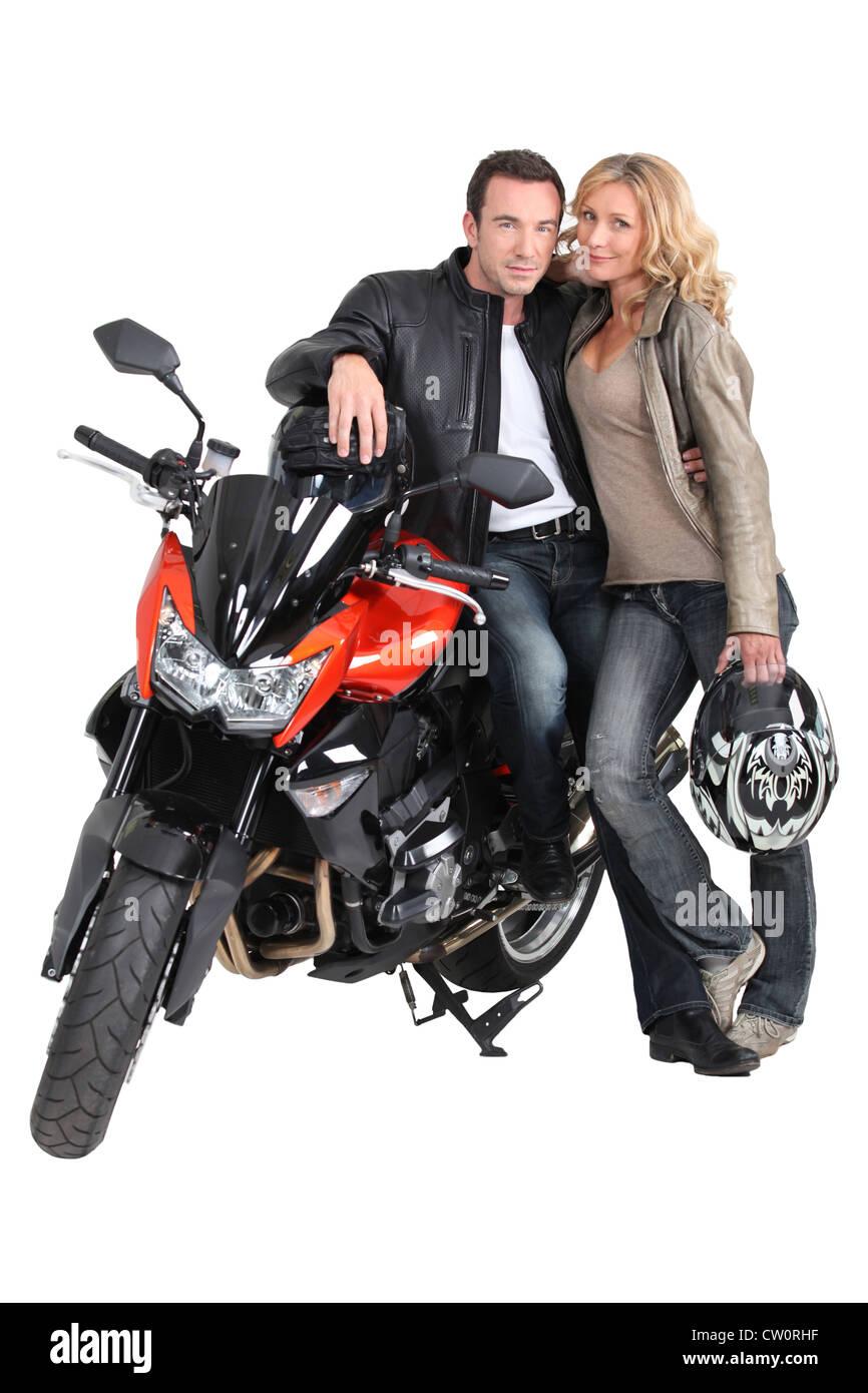 Biker Couple And Bike Stock Photo Alamy