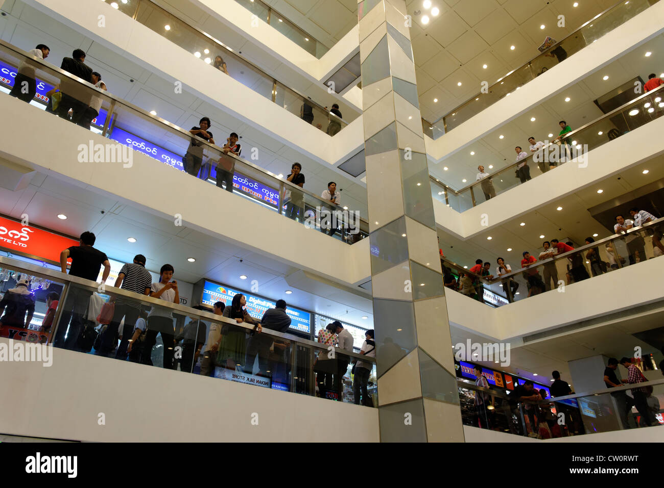 Filipinos gather in a Singapore shopping mall on Sunday afternoon - Stock Image