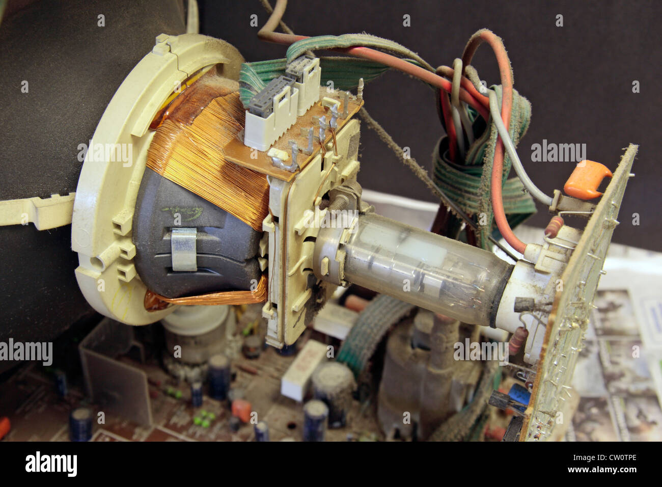 Close up view of the vacuum tube, electron gun and general wiring of an analogue cathode ray tube portable television. - Stock Image