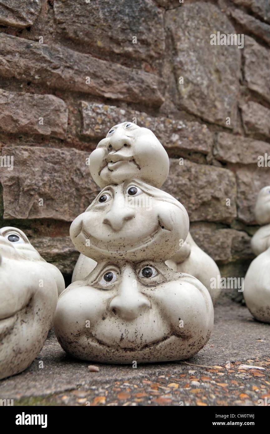 Amusing Garden Stone Ornaments On Sale In Corfe Castle, Dorset, UK.   Stock