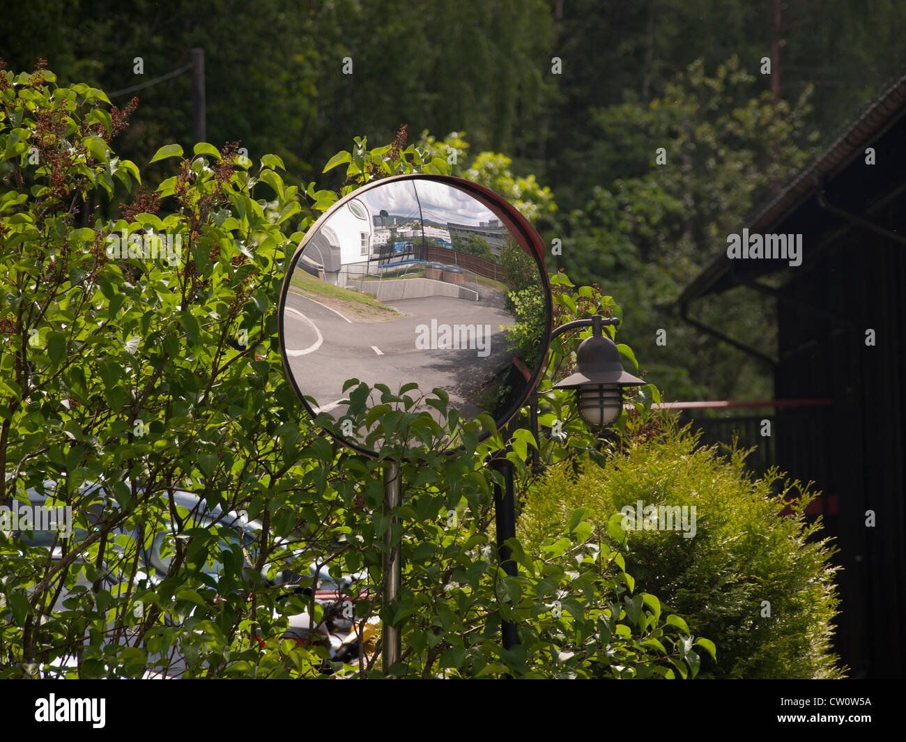 Spying Mirror Set Up To Help Drivers Identify Dangers Around The Stock Photo Alamy