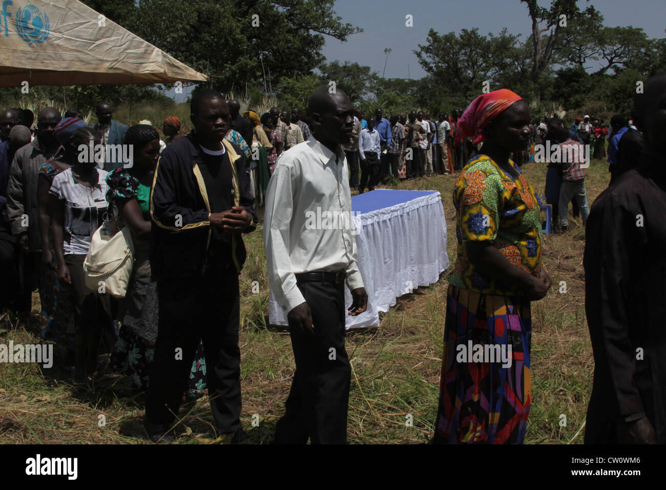 Mourners line up to pay respect to land dispute victim in Otuke District of Uganda - Stock Image