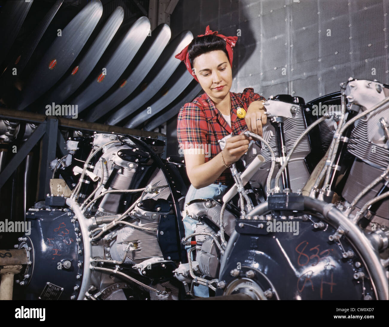 World War II Woman working on an airplane motor at North American Aviation Inc. plant in California 1942 - Stock Image