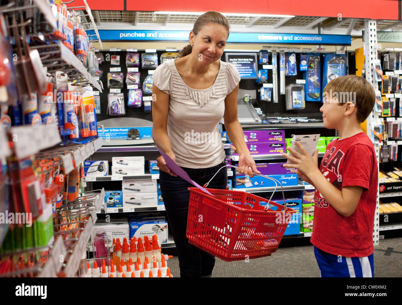 hispanic mom takes her 7 and 8 year old son shopping for first grade stock photo 49808082 alamy. Black Bedroom Furniture Sets. Home Design Ideas