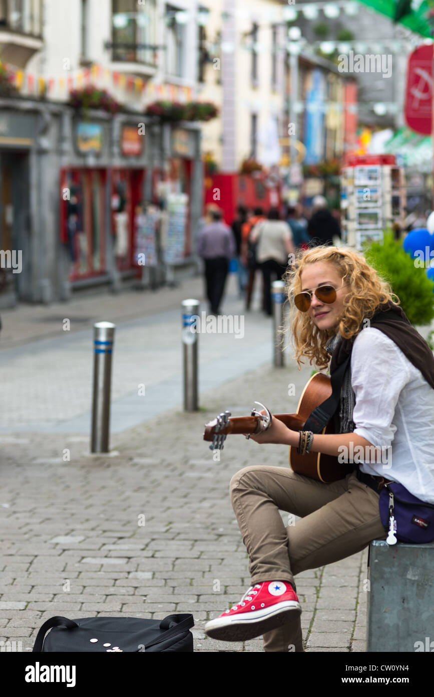Busker in Latin quarter of Galway City, County Galway, Republic of Ireland. - Stock Image
