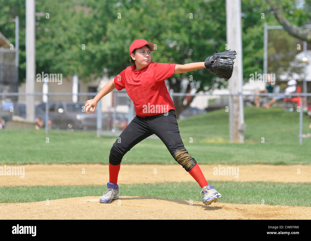 action shot of alittle league baseball pitcher on the pitcher's mound - Stock Image