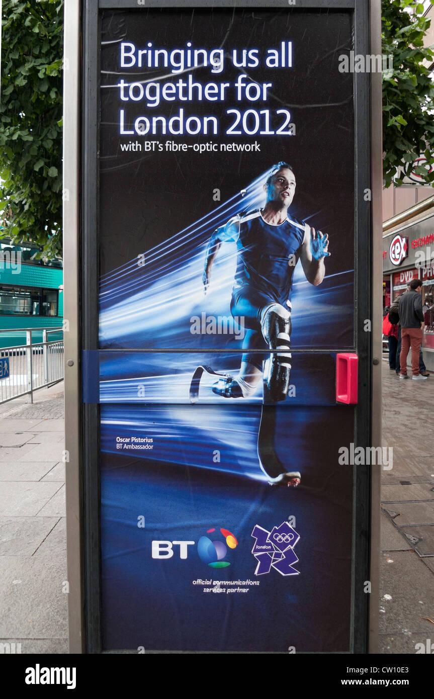 British Telecom sponsorship poster for Team GB Athlete Oscar Pistorius on a phone box during the 2012 London Olympics - Stock Image