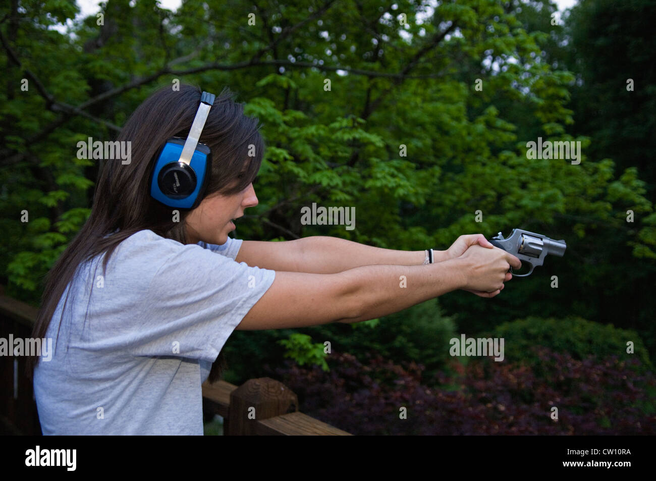 Teenage Girl Shooting a  38 Special Snubnose Revolver Stock