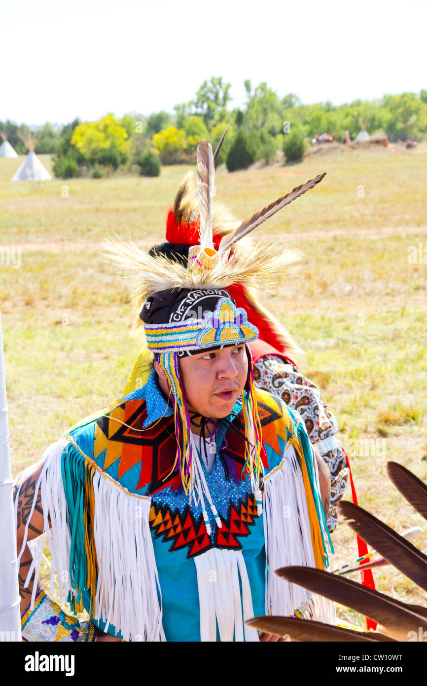 Members of five Plains tribes -- Apache, Arapaho, Cheyenne, Comanche and Kiowa -- gather at the 2011 Medicine Lodge - Stock Image