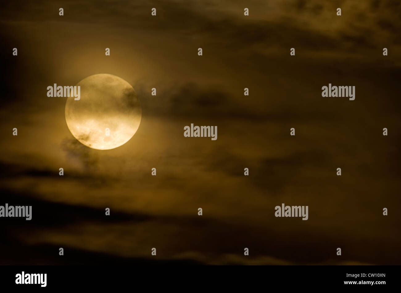 Full Moon and Wispy Clouds - Stock Image
