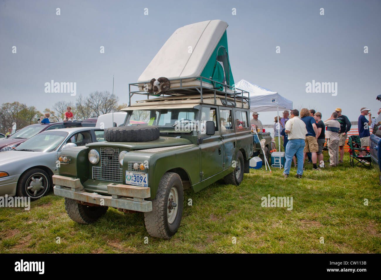 Cars parked for tailgate during horse races - Stock Image