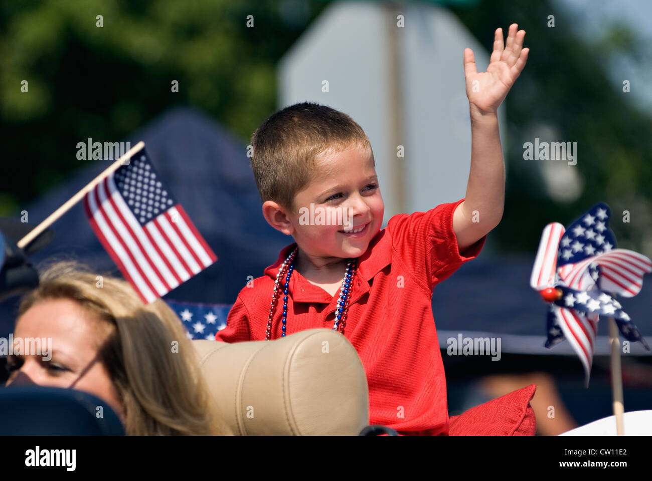 Prince Candidate Waving to Crowd in Independence Day Parade in New Pekin, Indiana - Stock Image