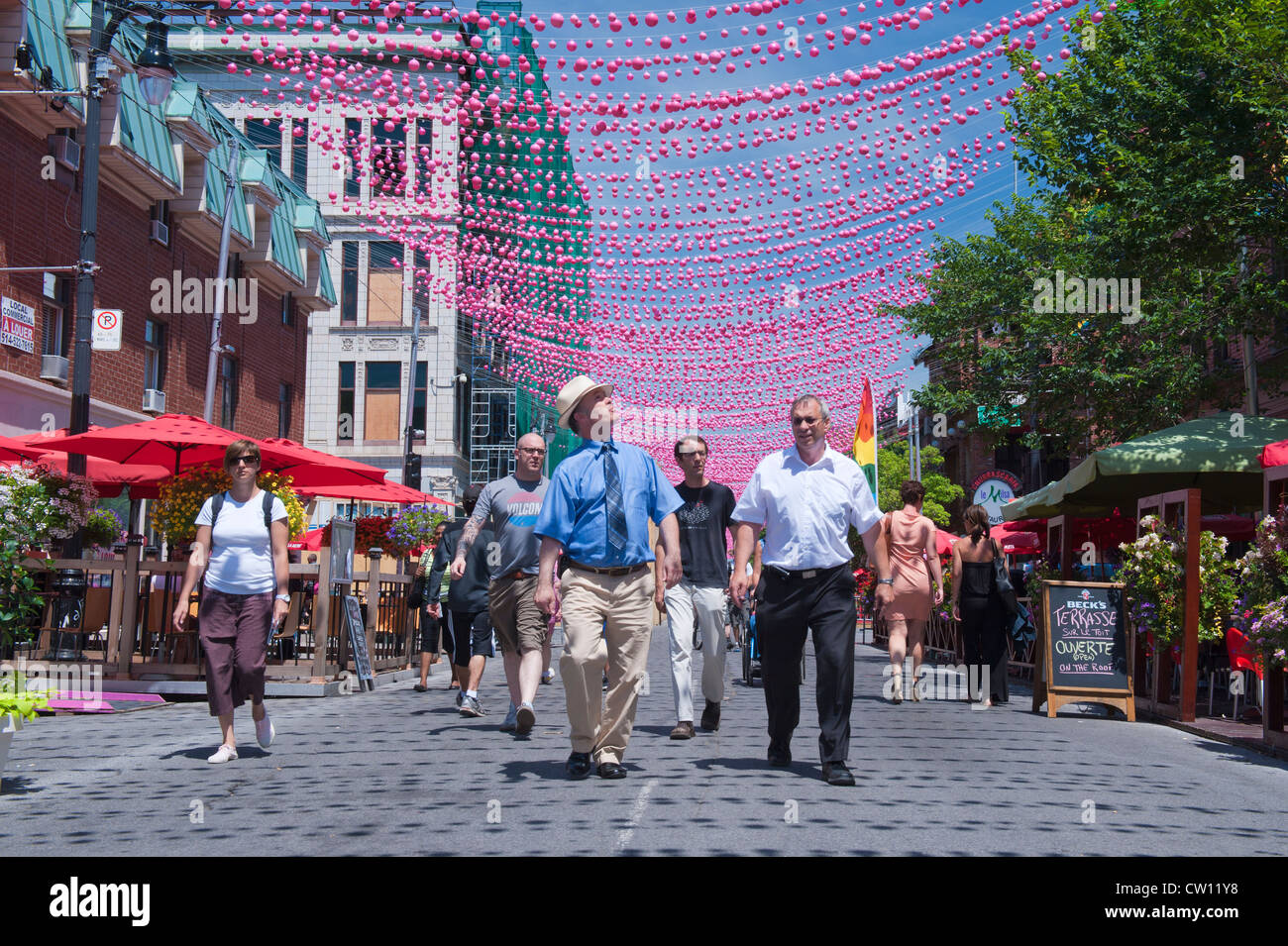 Pedestrians on a part Ste Catherine street which is closed to automobiles during summer months. Gay Village, Montreal. - Stock Image