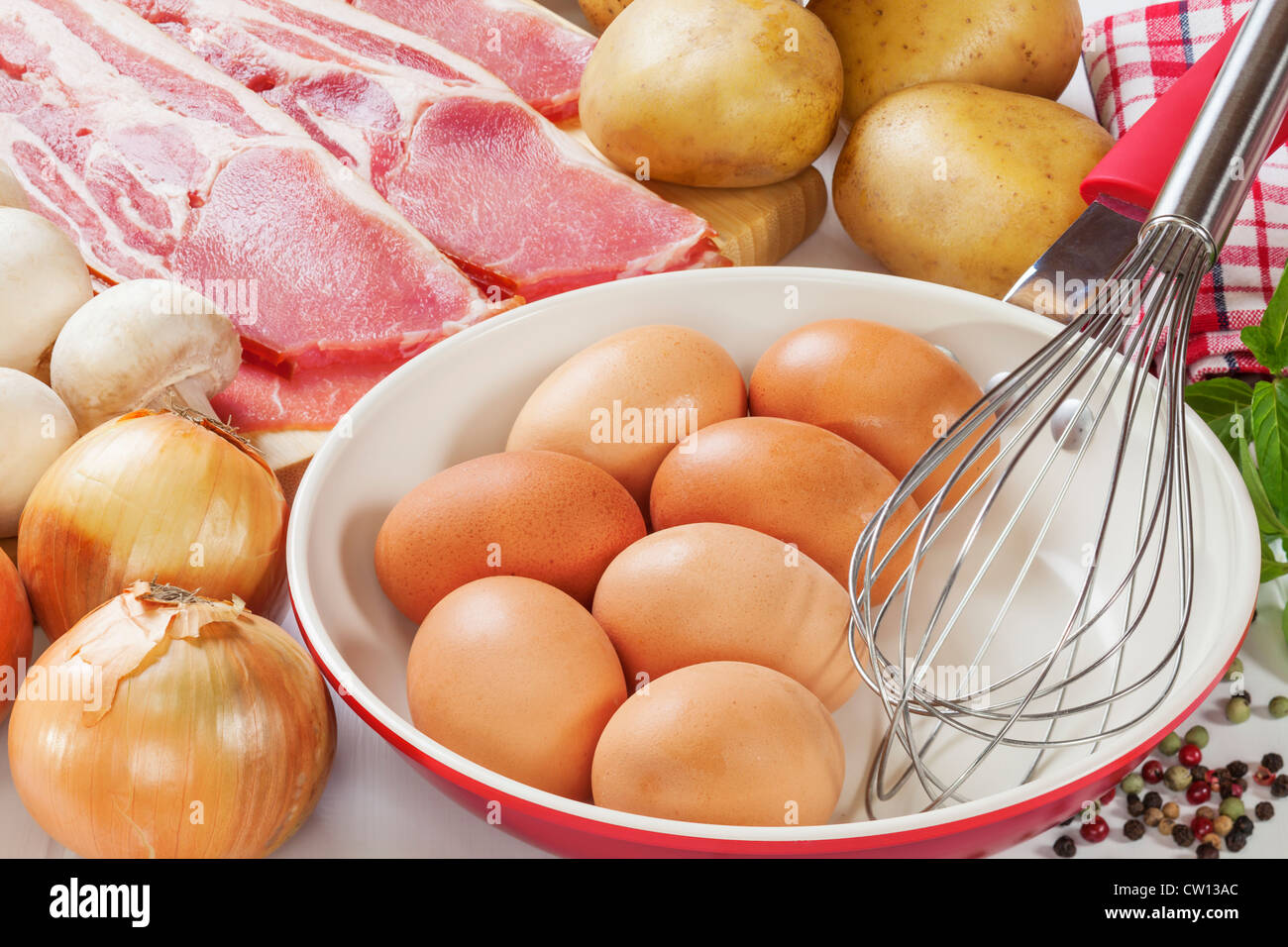 Ingredients for frittata with bacon, potato, mushroom and onion. - Stock Image