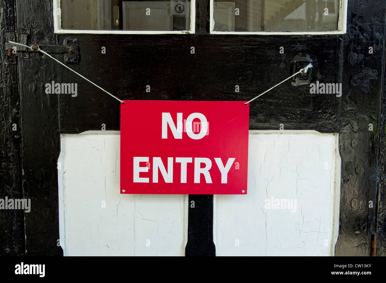 No entry sign hanging on door - Stock Image