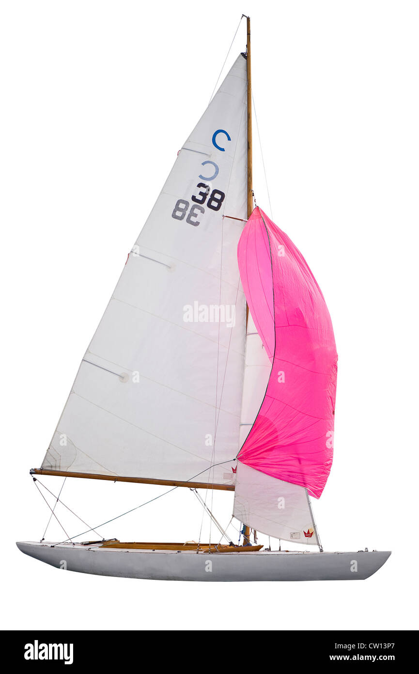 Sailing boat with red sail - Stock Image
