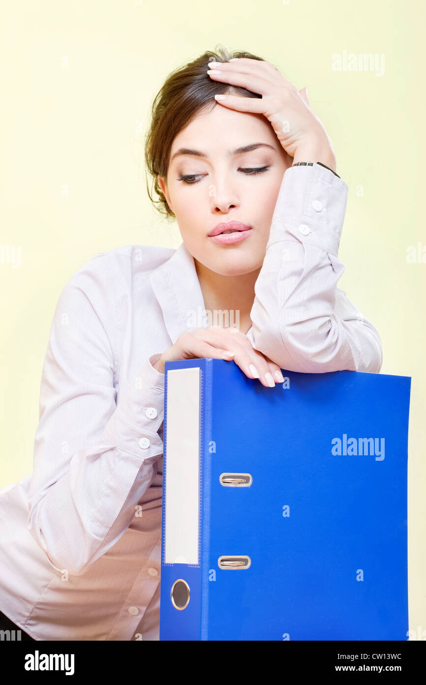 Serious or bored business woman with files - Stock Image