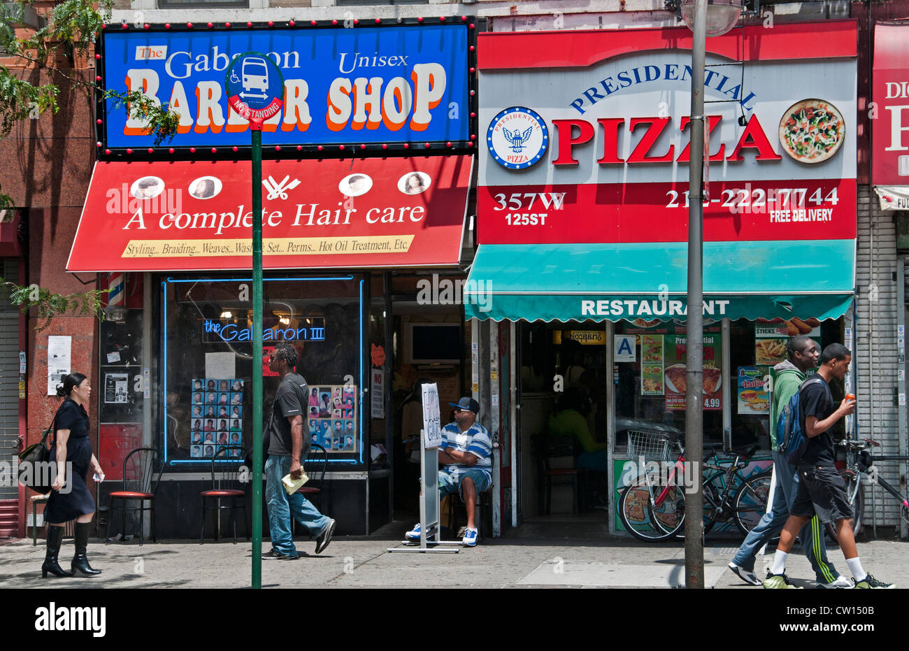 Barber shop Pizza Dr Martin Luther King JR Boulevard Harlem New York  Manhattan United States Stock Photo
