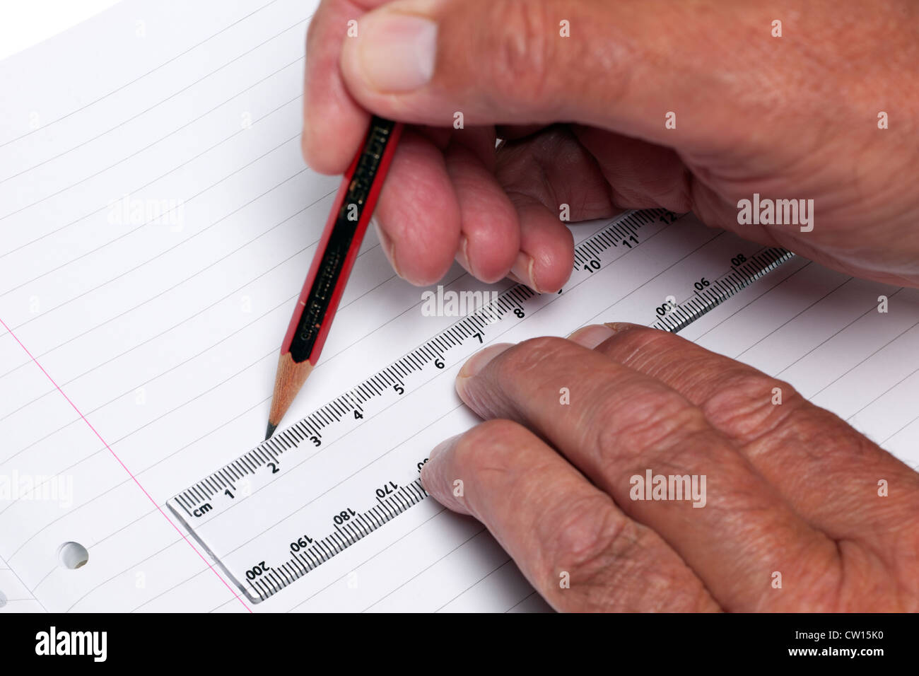 Measuring with a rule - Stock Image