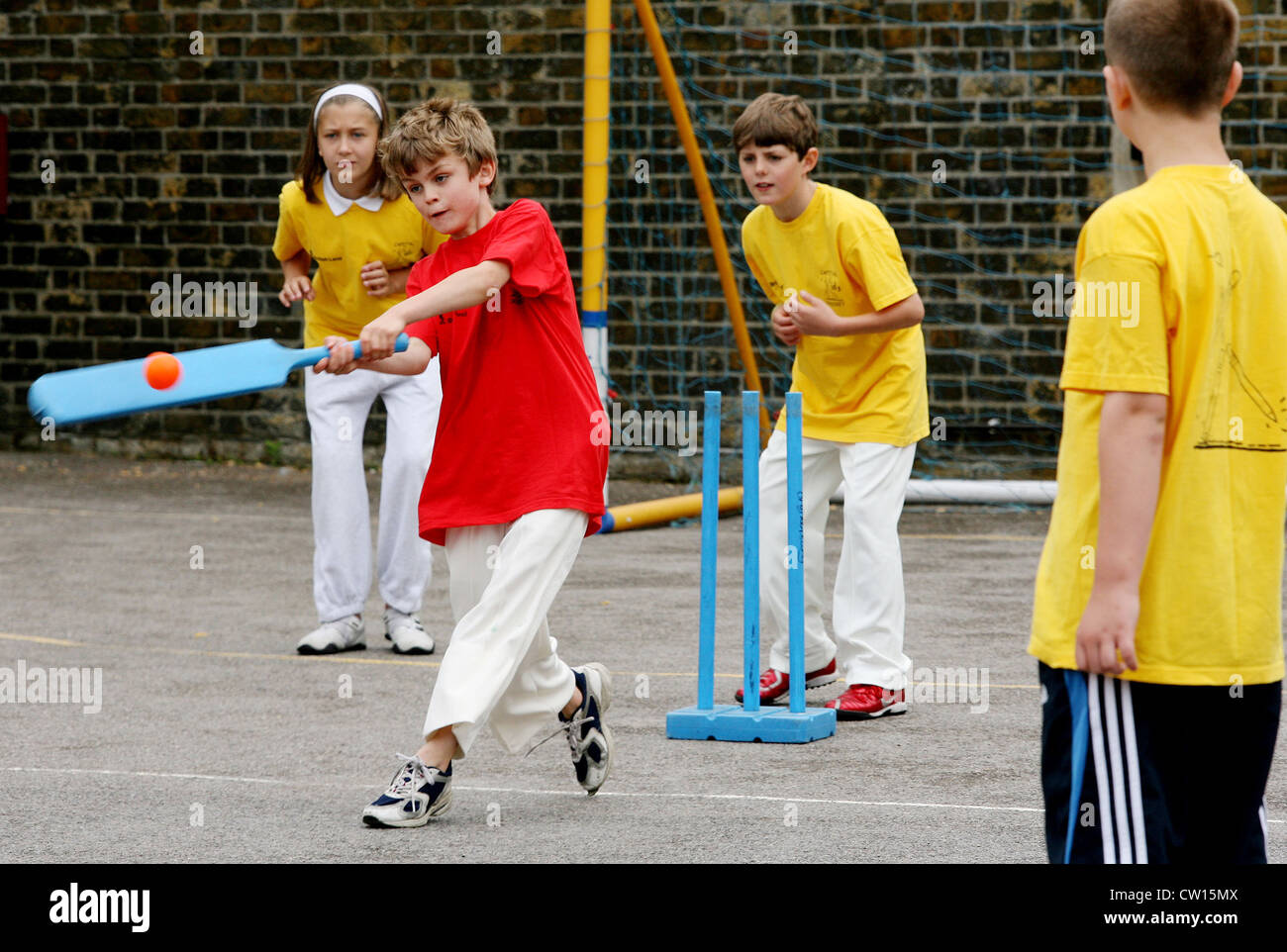 Year 6 Pupils at Brackenbury Primary School participate in a sports lesson in the playground, West London, England, - Stock Image