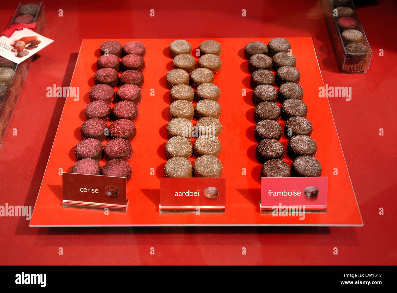 Brussels, Belgium. Shop window in the Galeries St Hubert. Confectionery - cherry, strawberry, raspberry - Stock Image