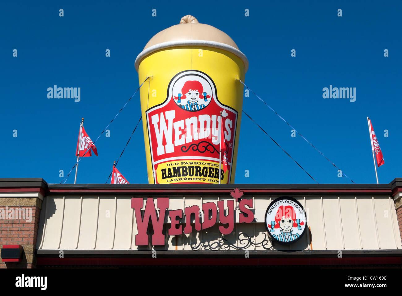 Advertising signs for Wendy's fast food hamburger milkshake restaurant Fort Erie, Ontario, Canada Stock Photo
