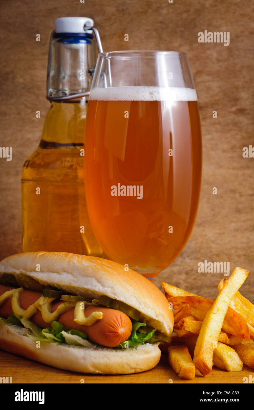 Fast food menu with beer, hotdog and french fries - Stock Image
