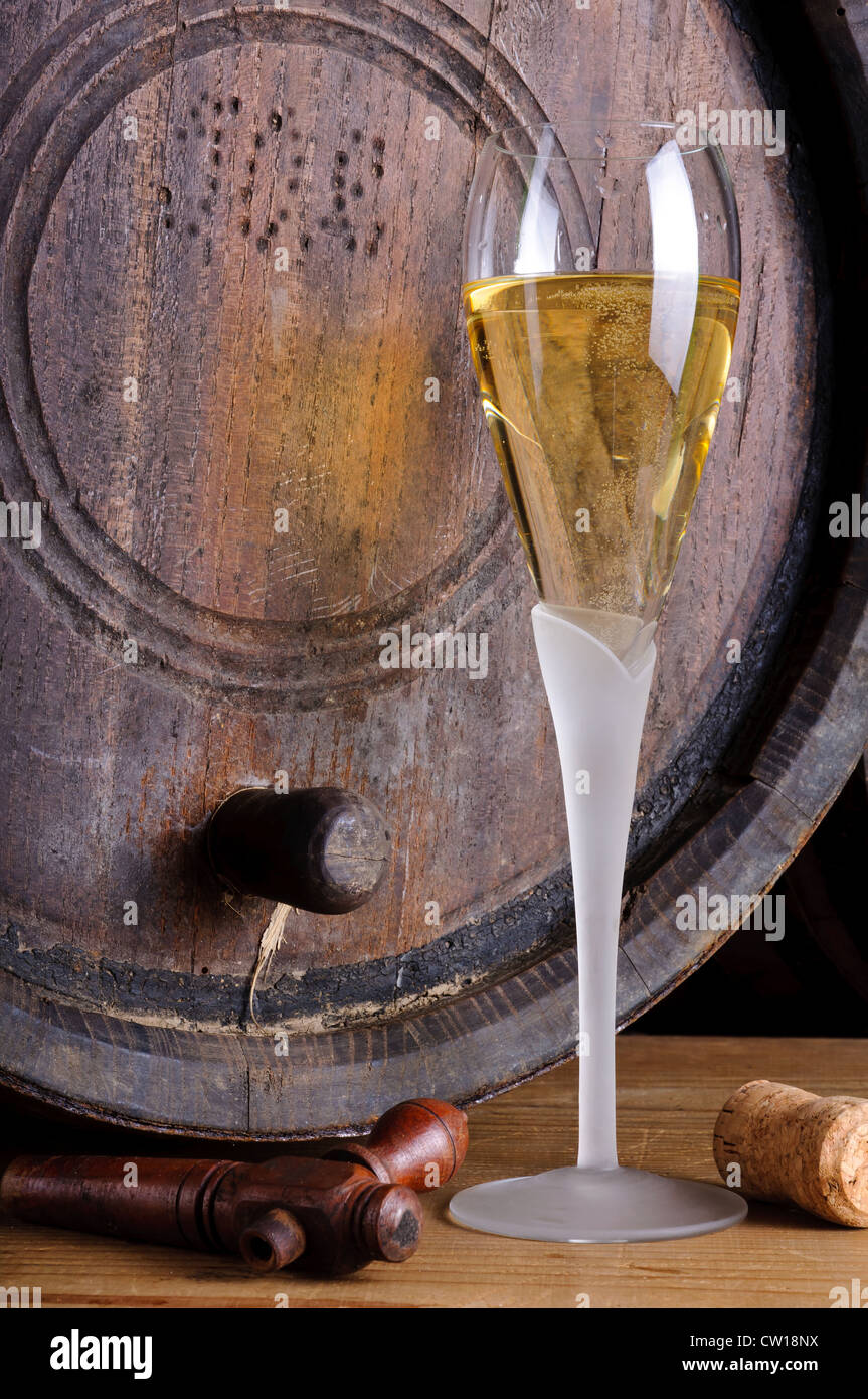 Still life with champagne glass and wooden barrel - Stock Image