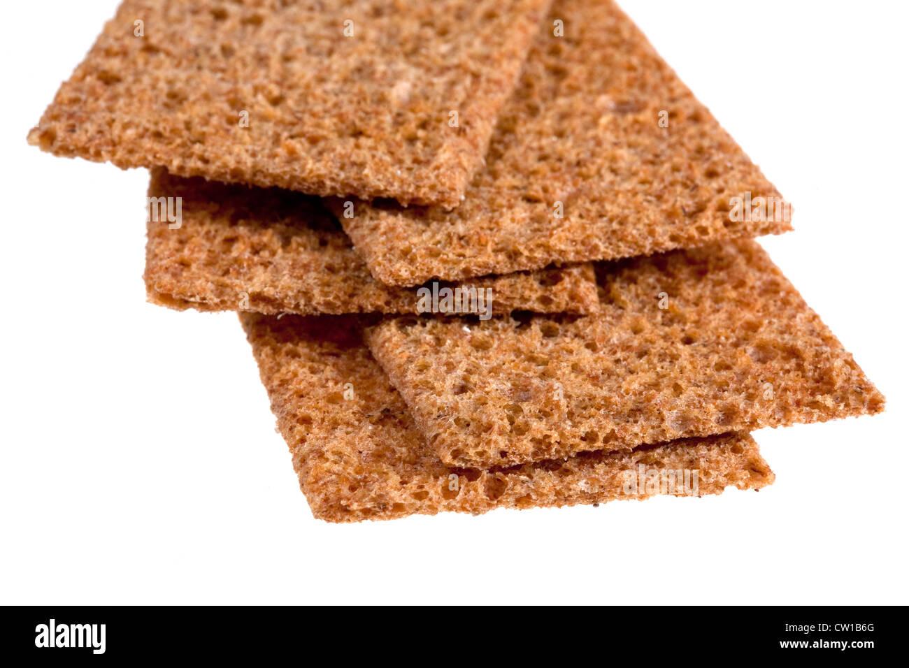 thin crispbreads close-up isolated on white - Stock Image