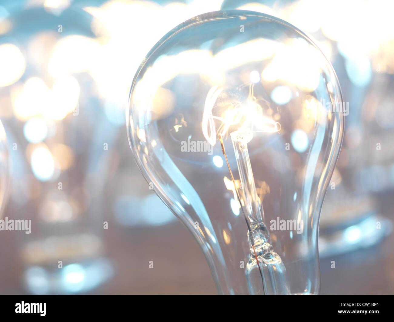 Closeup of lit up incandescent light bulbs. Power consumption concept. - Stock Image