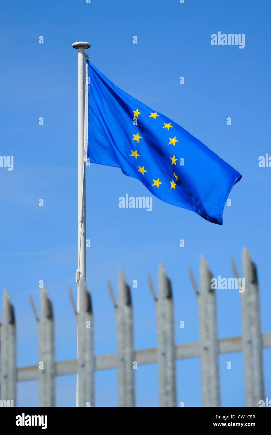 European union flag behind a security fence in the UK. - Stock Image