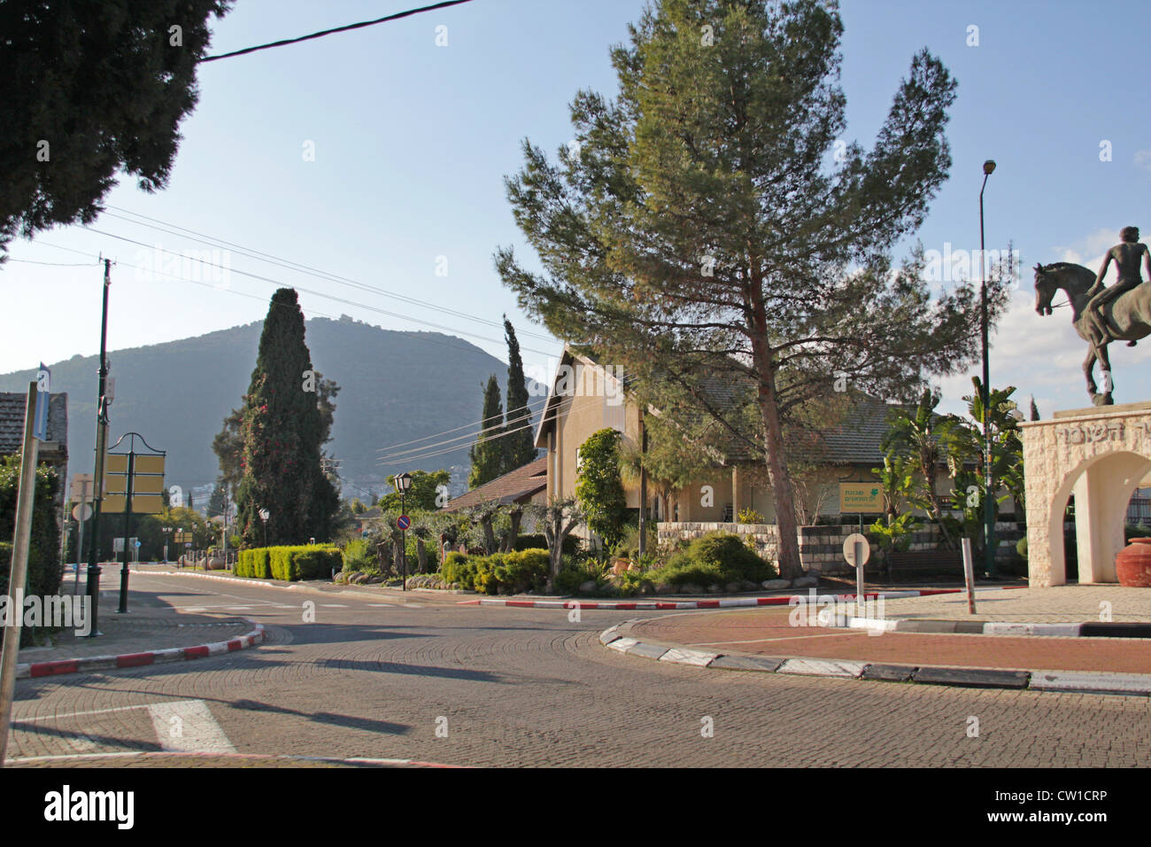 Kfar Tavor in Yezreel Valley and Tabor Mountain( Transfiguration), Israel. - Stock Image