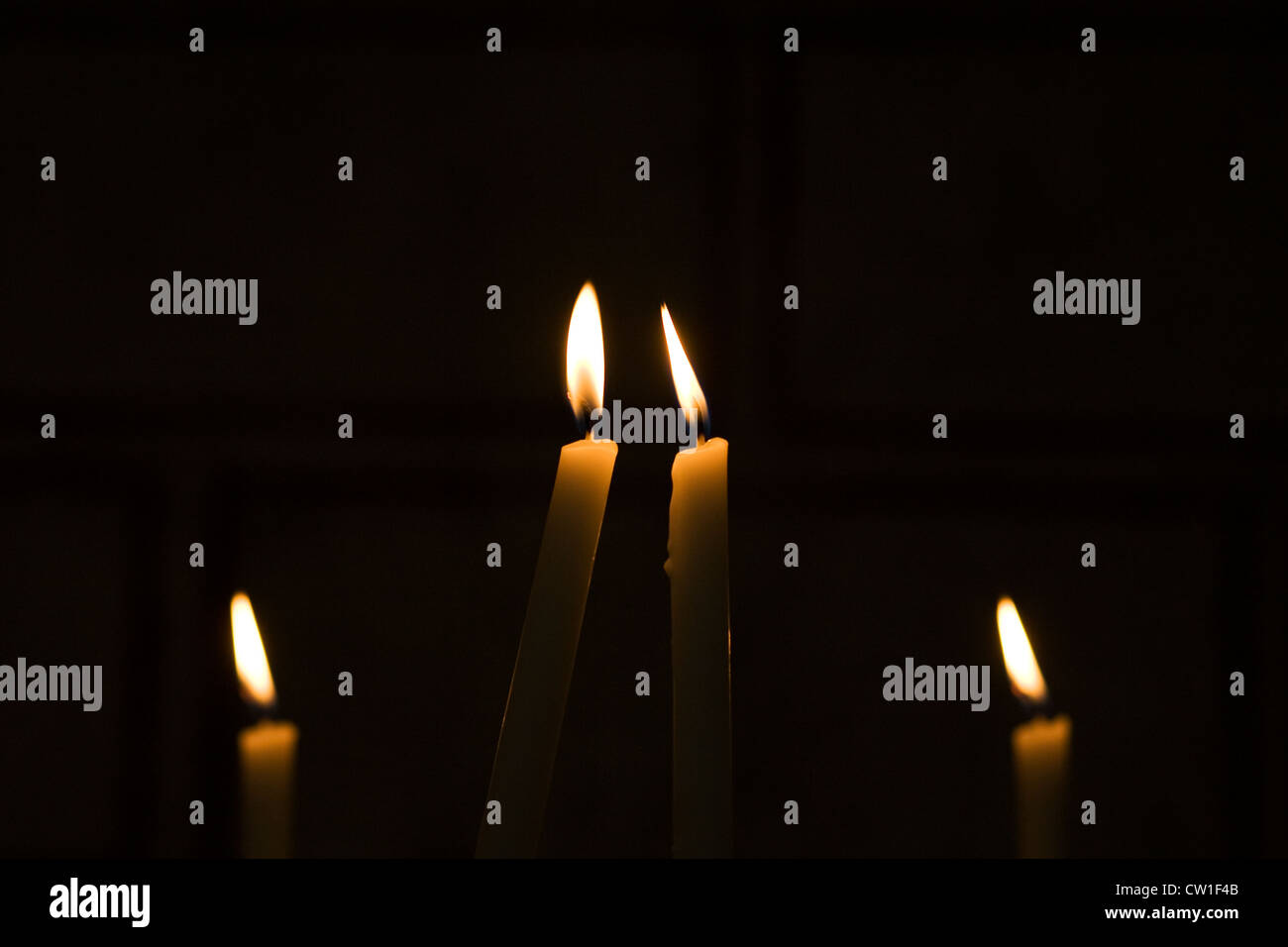 Four candles in the darkness. - Stock Image