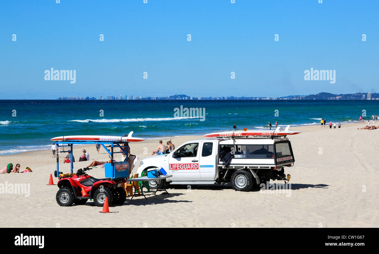 Lifeguard on beach patrol even in cold weather when the beach is sparsely populated emergency services are on watch. - Stock Image