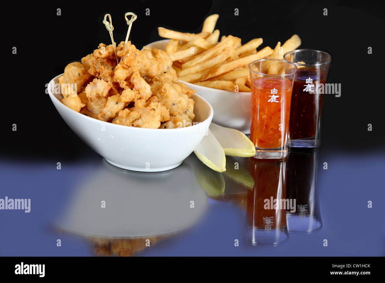 Chicken Tampura - Deep fried chicken and batter with french fries Stock Photo