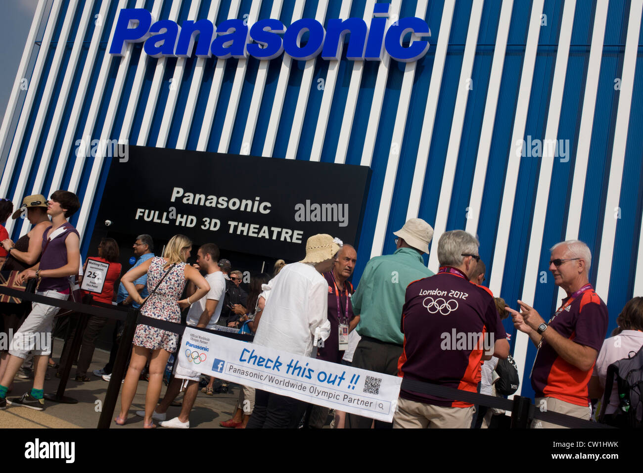 Spectators queue outside Panasonic's HD 3D theatre in the Olympic Park during the London 2012 Olympics. Panasonic - Stock Image