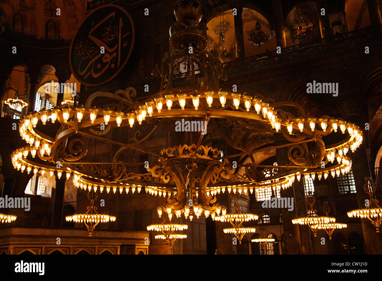 Grand chandeliers in the main hall of hagia sophia istanbul turkey grand chandeliers in the main hall of hagia sophia istanbul turkey a religious monument of historical significance aloadofball Images