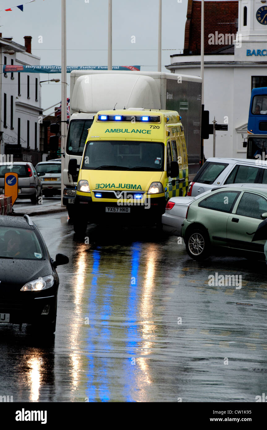 Ambulance in town centre in wet weather Stock Photo