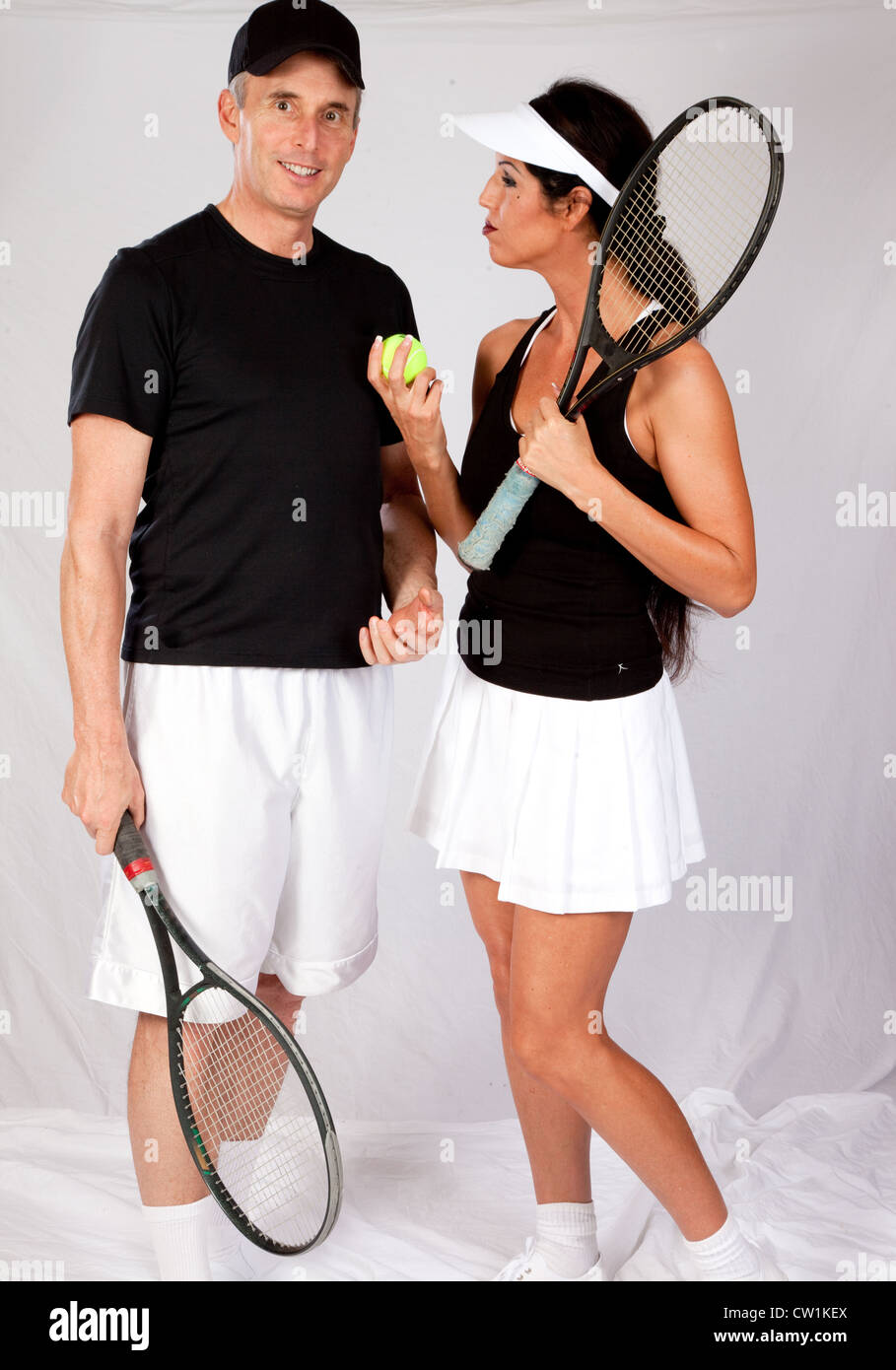 Cute Couple In Tennis Outfits Playing With Their Balls And Rackets Stock Photo Alamy