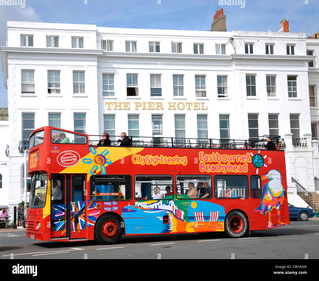 Eastbourne. Sightseeing bus in front of The Pier Hotel, in Eastbourne, East Sussex, England, UK. - Stock Image
