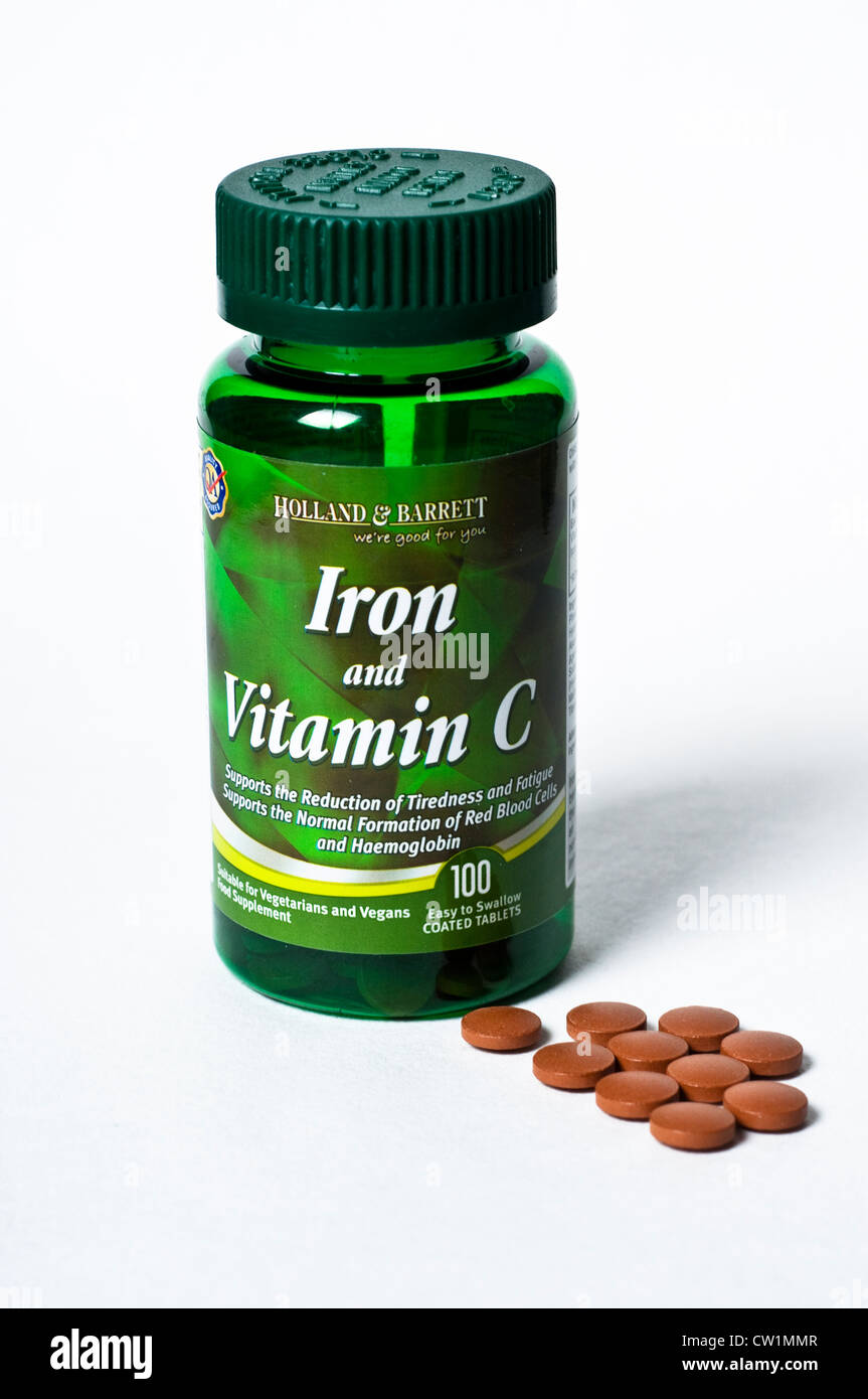 Iron and vitamin C tablets - Stock Image