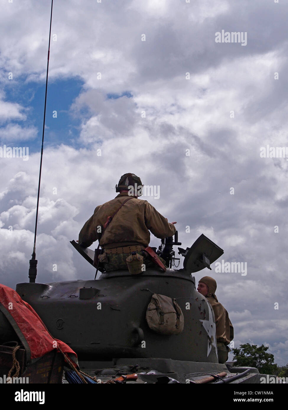 Tank commander in silhouette against sky on Sherman Tank at World War Two military vehicle show in Essex Stock Photo