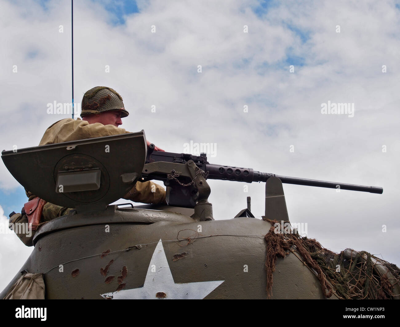 Close up of tank commander aiming machine gun on American Sherman Tank at Military Vehicle show in Essex 2012. Stock Photo