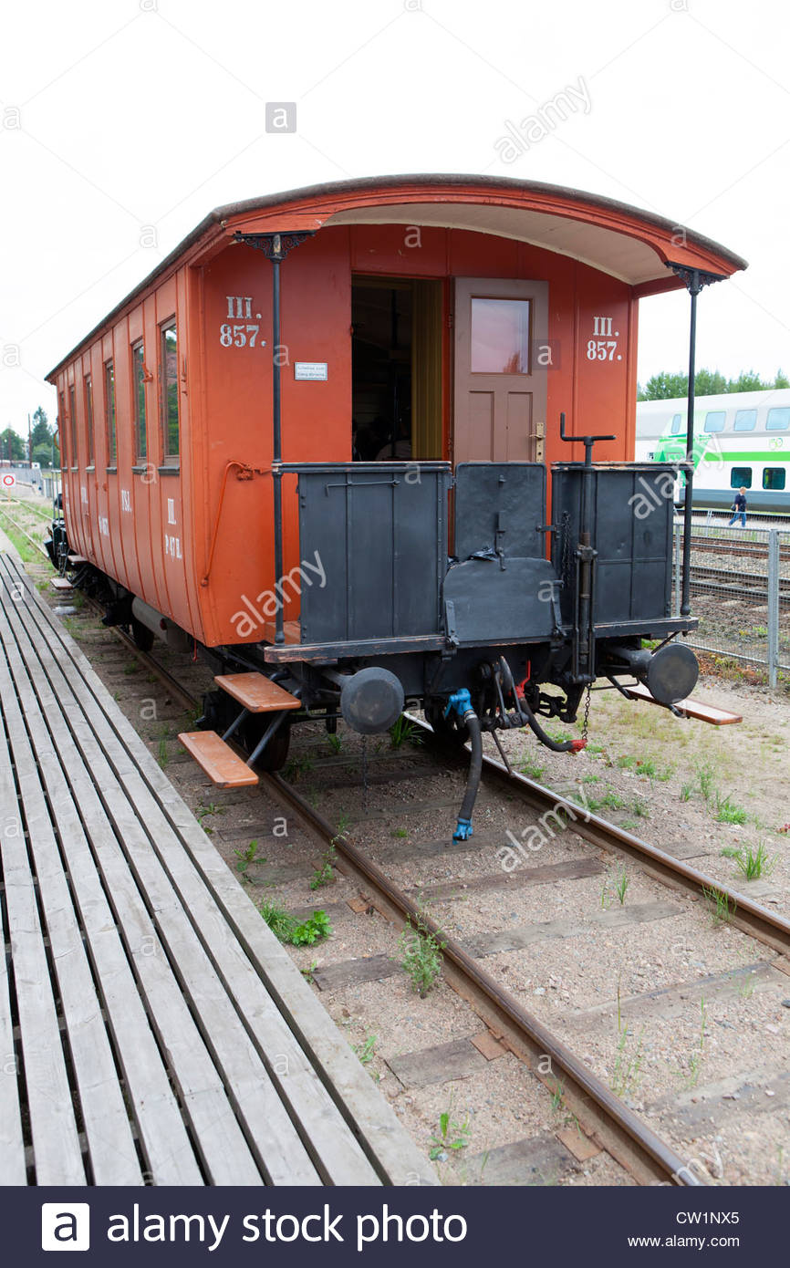 An old Finnish State Railways 3rd Class passenger car dating from the 1800's. - Stock Image