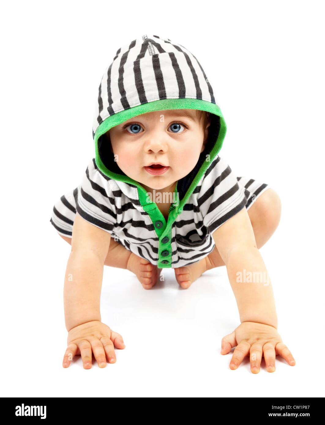 Lovely boy isolated on white background, sweet little baby wearing striped sliders, charming small kid in black Stock Photo