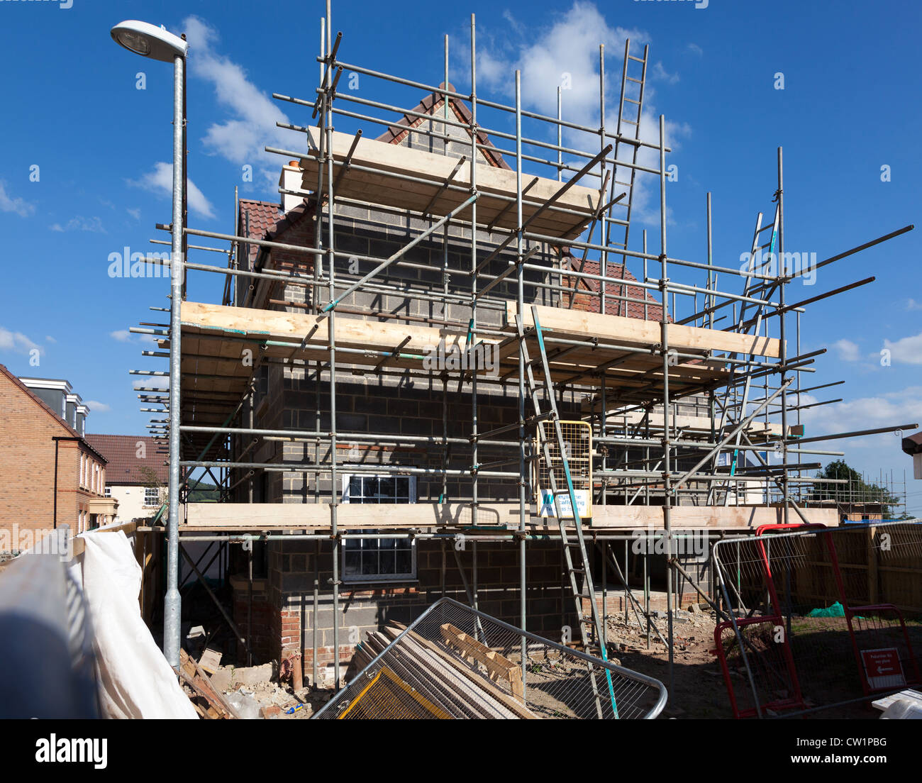 New build house on new estate under construction with scaffolding, Abergavenny, Wales, UK - Stock Image